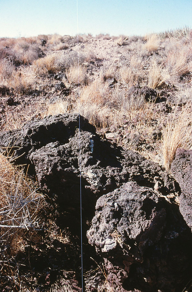 These boulders were the first point of contact made by aircraft's propeller blades. An aluminum transfer made by the spinning propeller can be seen on the rock's surface.