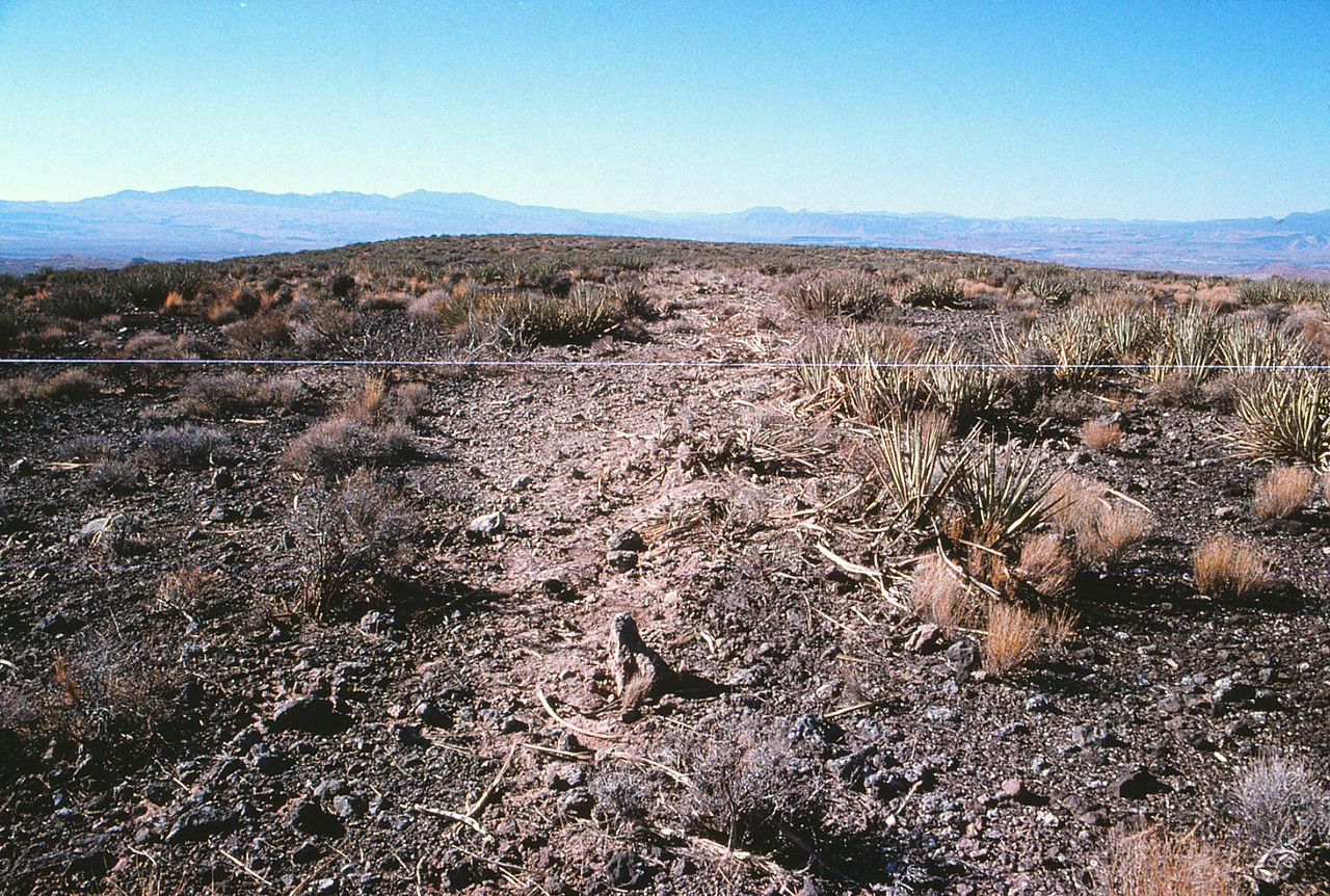 Looking northwest across the debris path. The aircraft flight path and subsequent ground scars litteraly formed an orientation line directly towards St. George Municipal Airport (KSGU).