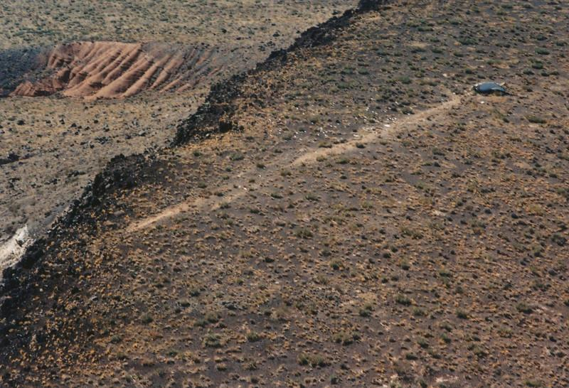 This aerial photograph taken the day after the accident illustrates two impacts made by the aircraft as it cartwheeled across the mesa.