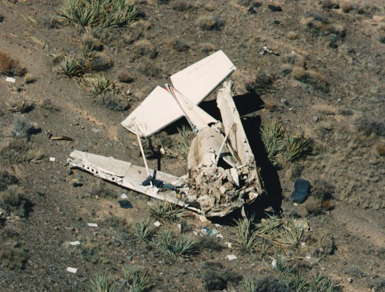 The fuselage inverted and crushed, a majority of the damage was taken by the forward section of the aircraft. There is no doubt from this photo that the pilot was killed instantly on impact.