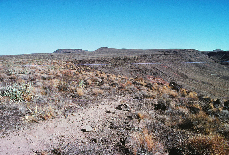 The first point of contact was made on the southern edge of the mesa and was glancing strike with the propellers. The initial impact was hard, but few pieces of the aircraft structure were located here.