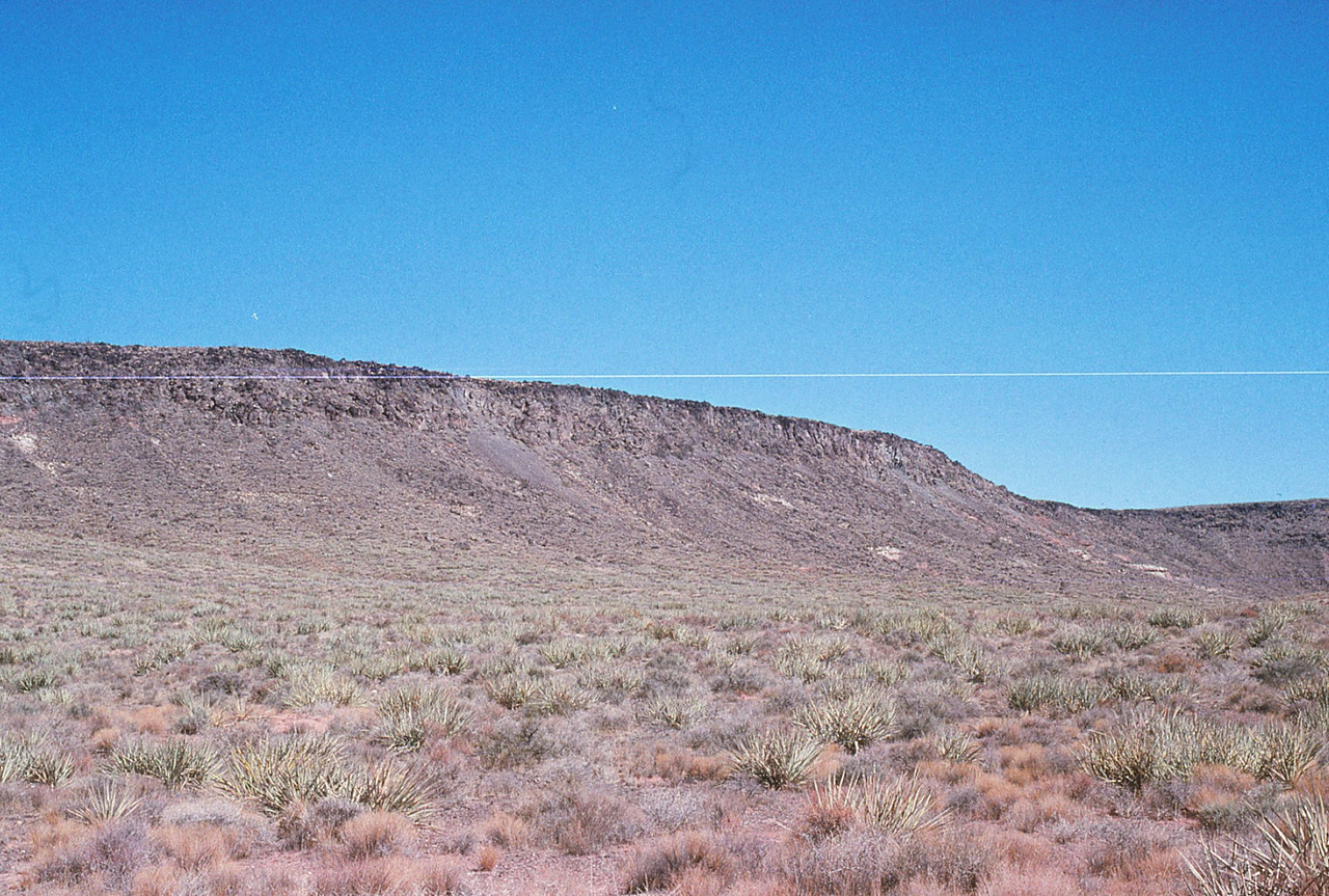 At night, this 4,600 foot mesa was virtually invisible to the pilot as he decended towards the lights of St. George.
