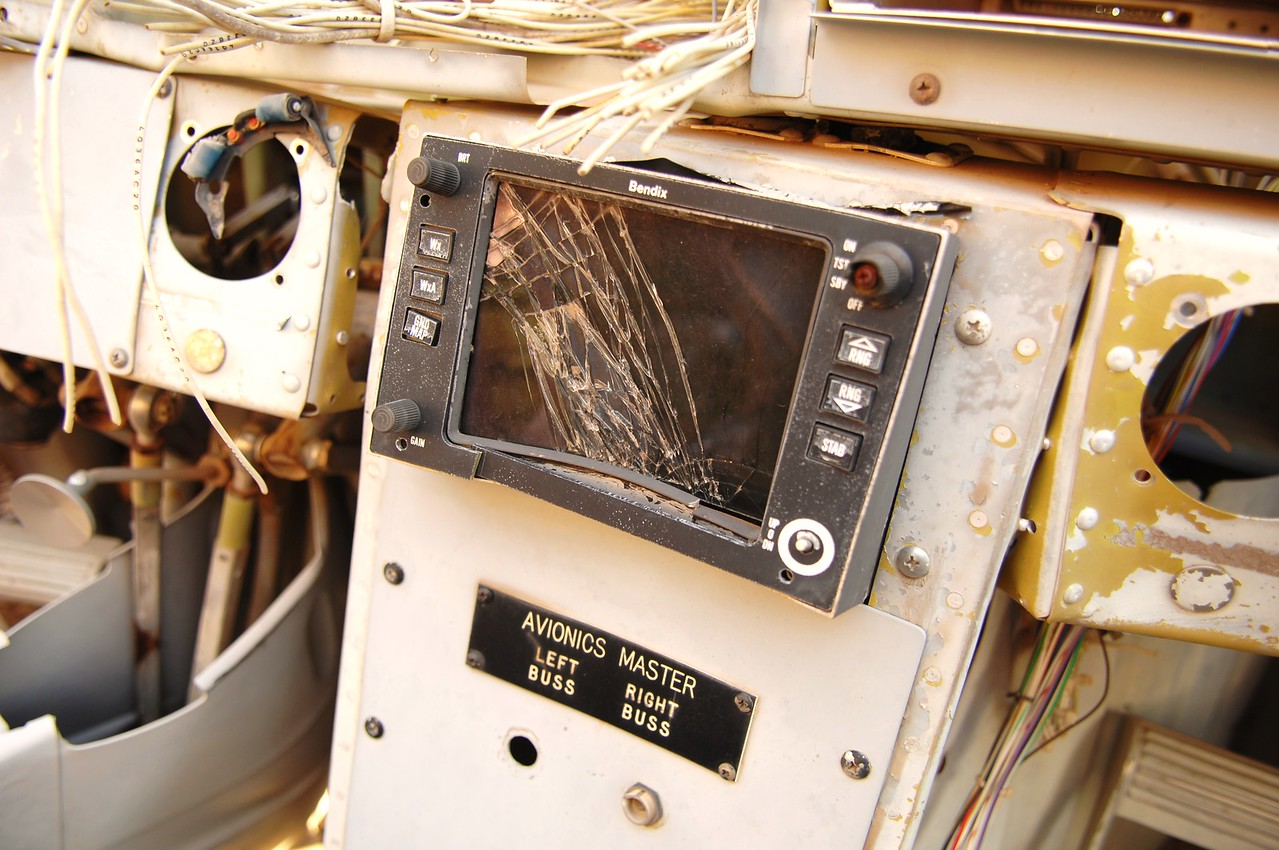 The destroyed weather radar display is still mounted in place.