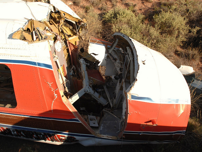 This view of the pilot's flight compartment illustrates the extensive damage sustained to this portion of the aircraft.