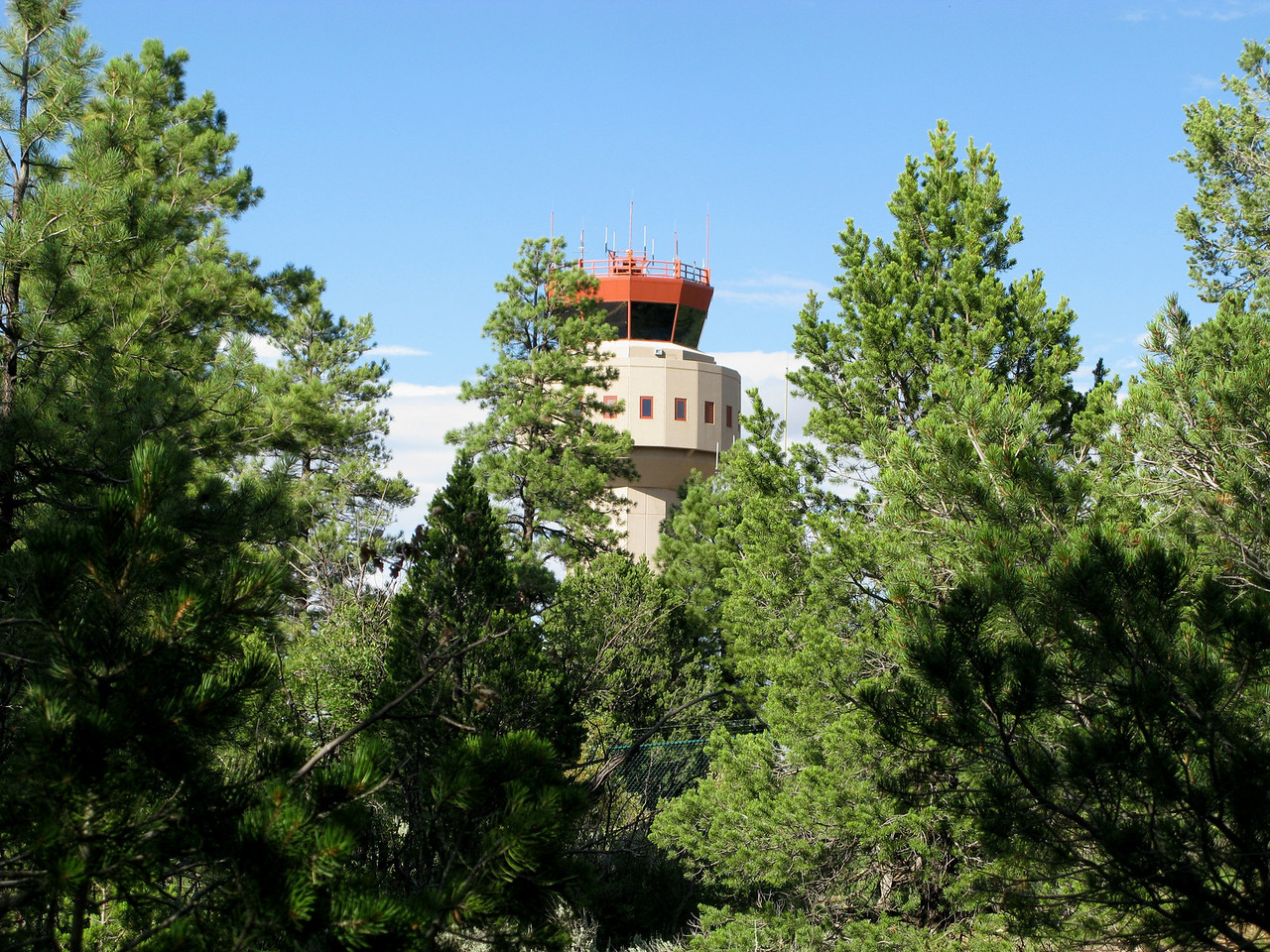 """Another facility recently built near the crash site of """"Canyon 5"""" is the new air traffic control tower. <br /> <br /> Constructed just north of the crash site, the facility opened on May 21, 2003 and subsequently replaced the old control tower on the west side of runways 03 and 21."""