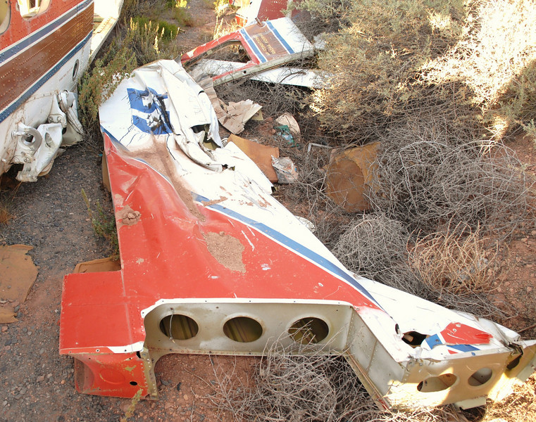 """The vertical stabilizer with a large number """"5"""" at the the top was also positioned next to the fuselage. Complete except for the missing rudder control surface. <br /> <br /> The rudder probably had minimal damage and may have been salvaged as a repairable aircraft part."""