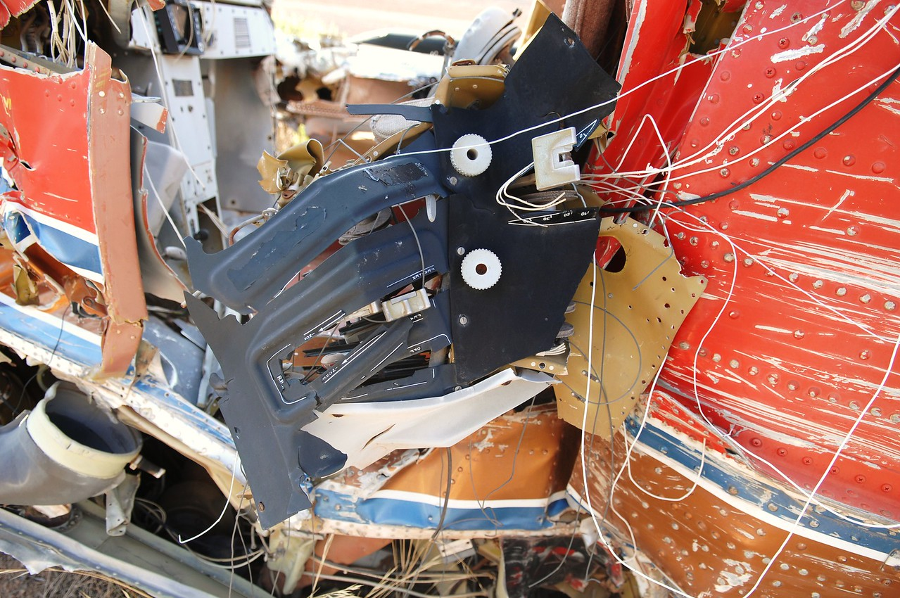 Unique to the Twin Otter designed aircraft is that the power, propeller, and fuel levers are all located on an overhead panel. <br /> <br /> Here we see the overhead panel ripped from its mounts and connected by only a few cables.