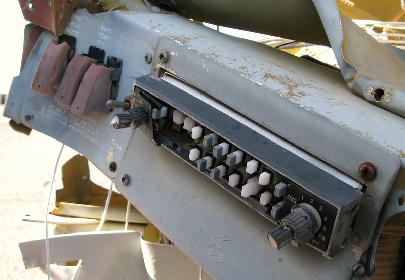 The guarded switches on the lower left side of the instrument panel are still intact while the audio panel is completely destroyed.