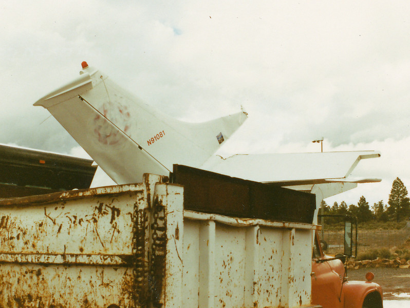 "The tail section and other aircraft parts were placed in a dump truck. While the ""N"" number remains intact, Windrock Aviation personnel spray painted over the companies logo to hide the identity."