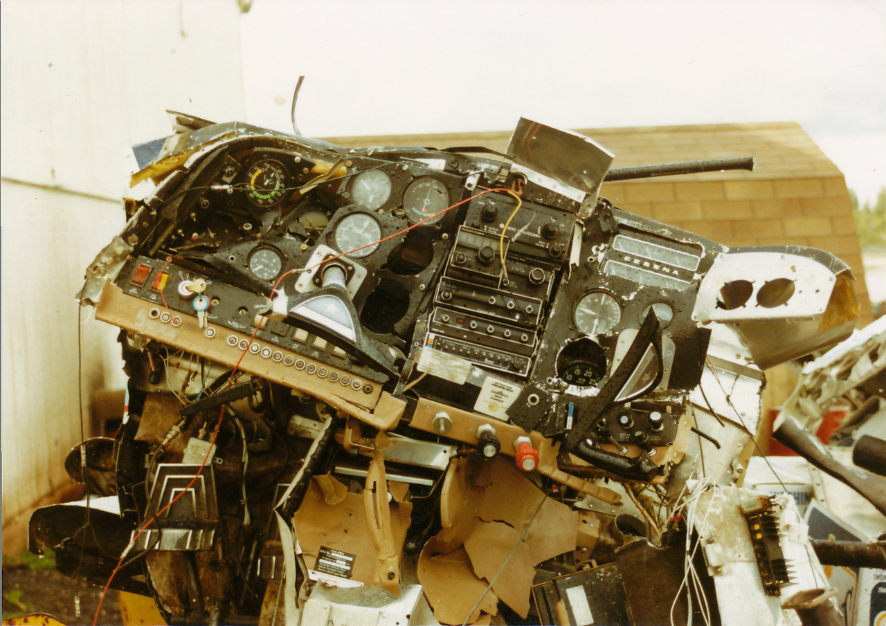 The aircraft forward section sustained a majority of damage. This photo of N91081's instrument panel illustrates the devastating damage inflicted in the accident.