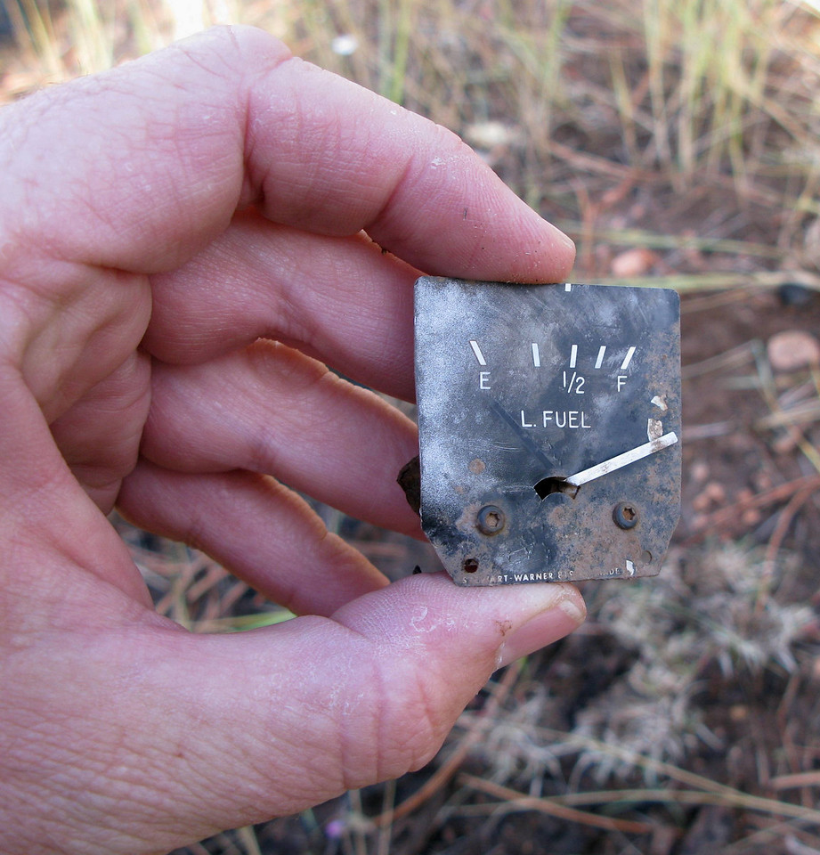The aircraft cockpit area was severely damaged in the accident, so it was not too surprising to find small instruments such as this fuel gauge in the debris field.