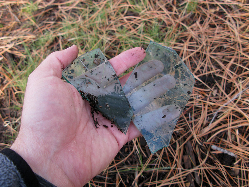 This tinted window Plexiglas was relatively thick and probably came from the forward windscreen of the aircraft.