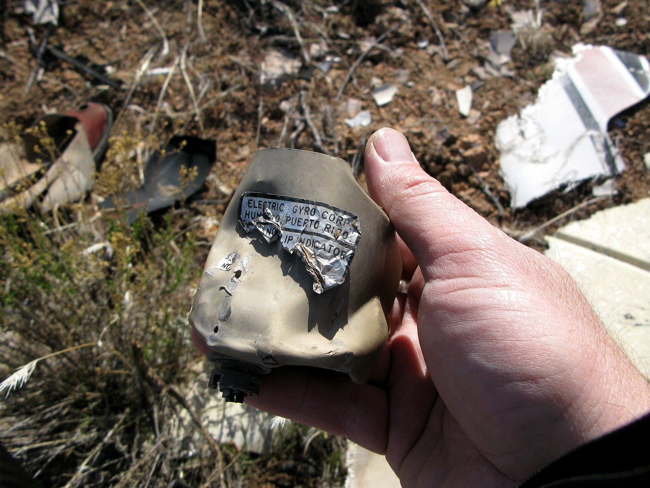 There were very few flight instruments located at the site. This electric Turn and Slip Indicator was barely recognizable and could only be identified by the identification data tag.