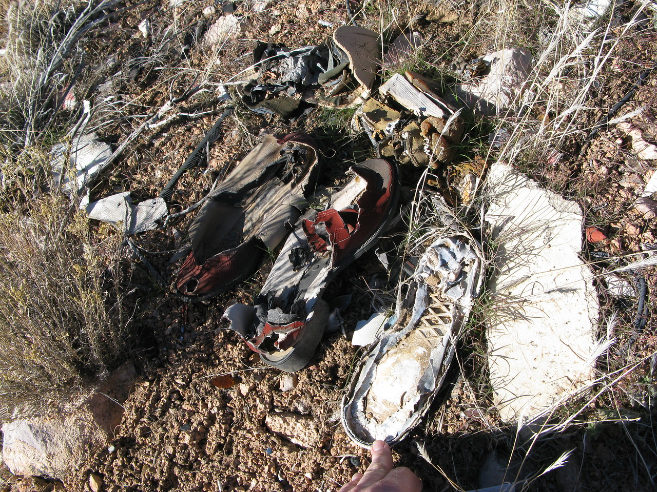 The shoes, exposed to over three decades of weather show signs of deterioration. It won't be long and these clothing articles will be gone forever.
