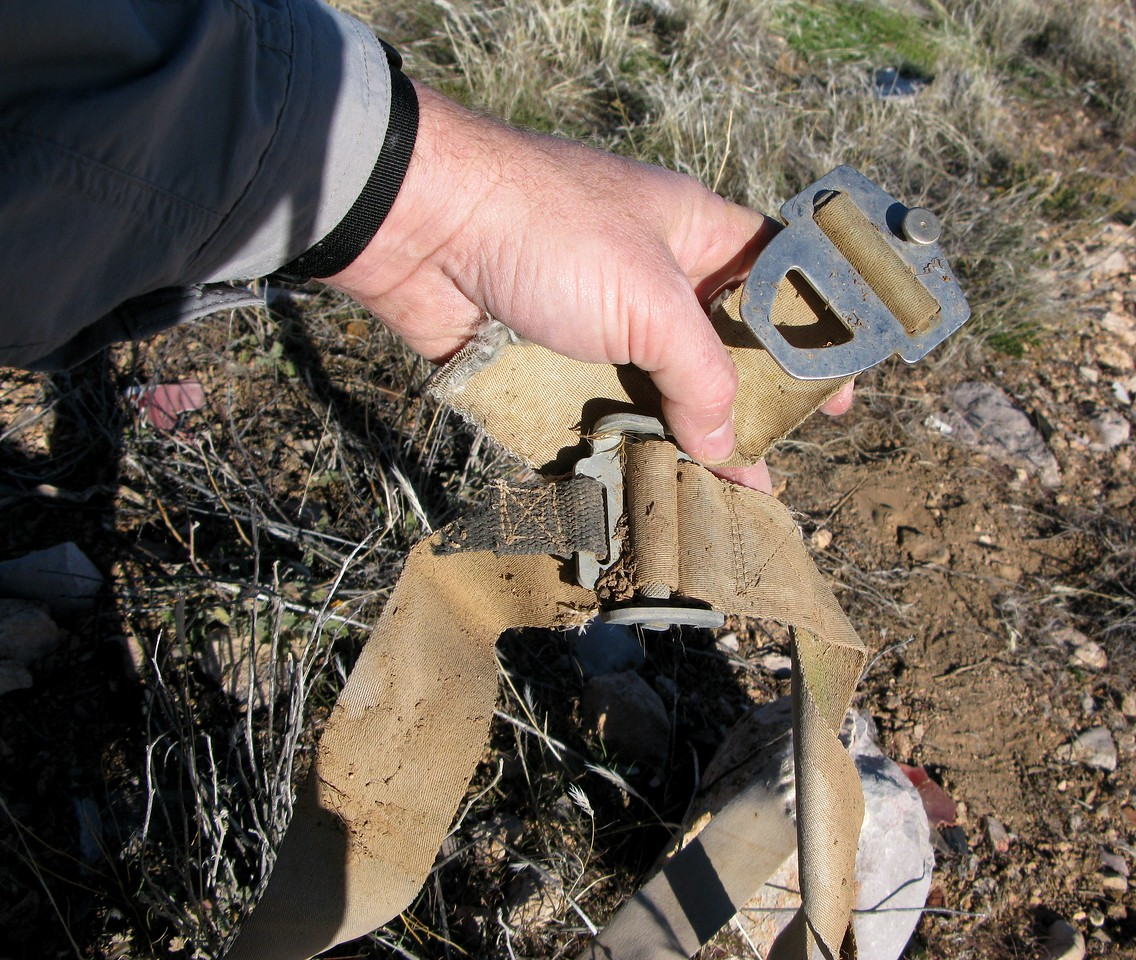 The remains of a combination seatbelt/shoulder harness (one of two installed) would have been used by the pilot or front seat passenger.