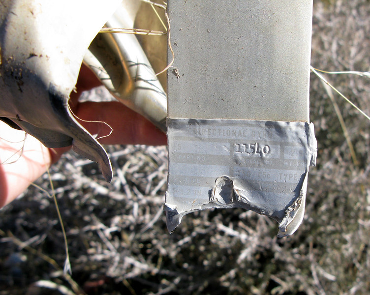 The empty casing of this Directional Gyro Indicator appears to have been cut open by accident investigators to examine the gyro's internal components for correct and proper operation.