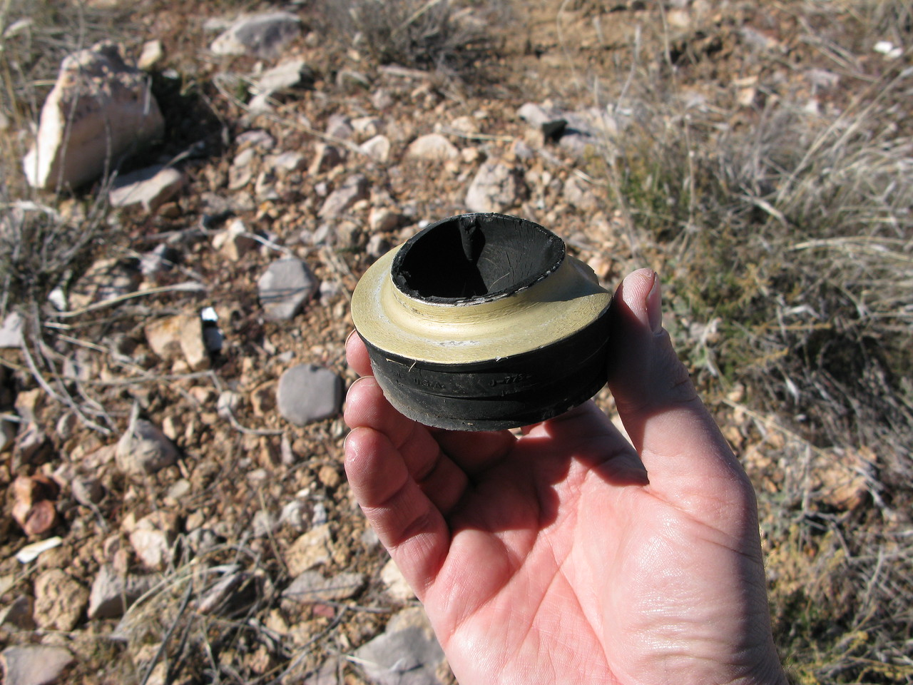 An aircraft engine vibration shock mount located at the impact site.