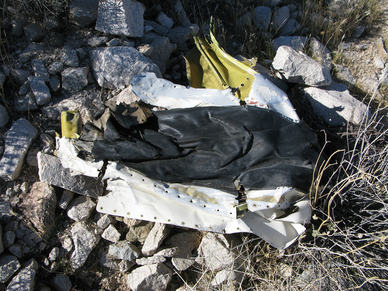 This wing leading edge was flattened out by the impact. Attached to the fragment was a piece of the rubber de-ice boot.