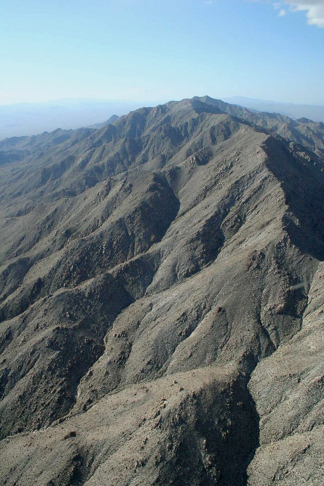 "This rugged 20 mile escarpment of steep desert peaks is known officially on the map as Mount Wilson, but area pilots refer to it as ""Wilson Ridge"".<br /> <br /> The ridgeline with a summit of 5,445 feet encompasses both Bureau of Land Management (BLM) Land (Mount Wilson Wilderness Area) and the Lake Mead National Recreation Area."