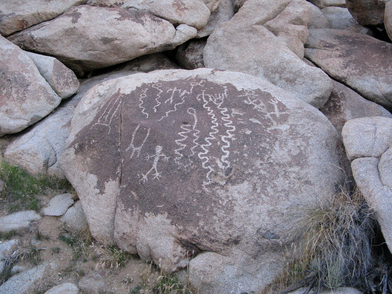 PREHISTORIC EVIDENCE<br /> <br /> This area of Mohave County is rich in archaeological resources, so it was of little surprise that I would find a panel of well preserved petroglyphs on my hike up Wilson Ridge.