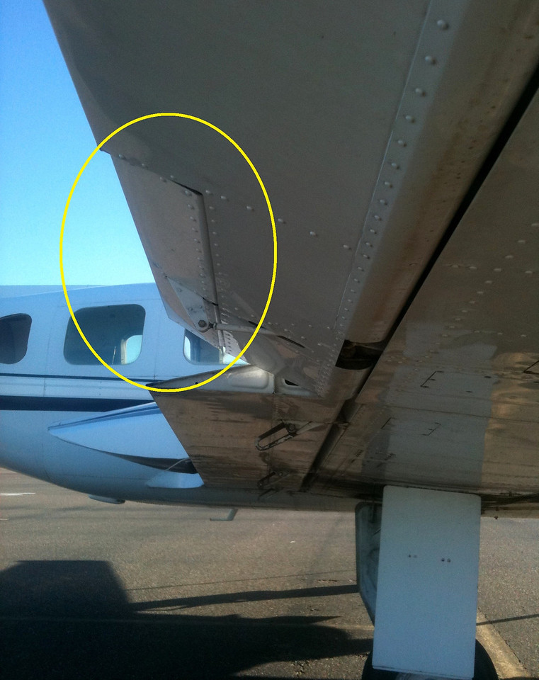The aileron trim tab located on the right wing assists in reducing roll control forces.