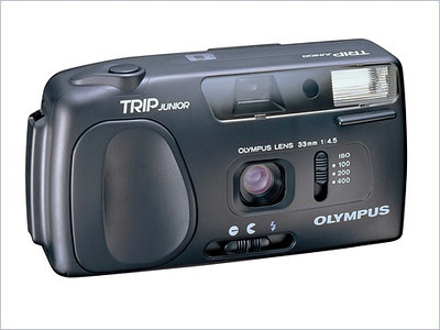 "The Olympus ""Trip Junior"" Camera was introduced in early 1990. It was an inexpensive simple to operate 35mm film camera."