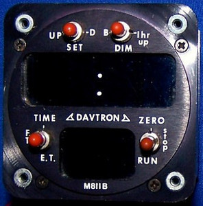 The Davtron M811B Digital Clock has a 3 function and six digit display. It features local time, flight time, and an elapsed time counter.