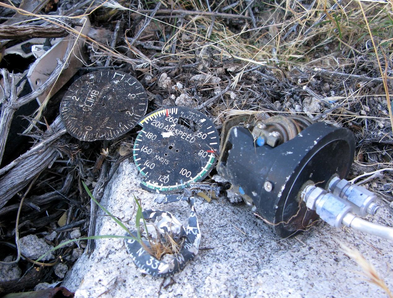 An assembled collection of aircraft pitot-static cockpit flight instrumentation found at the crash site.