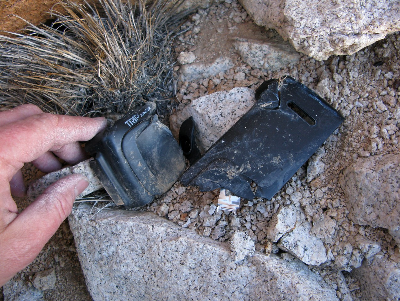 A passenger's mangled point and shoot Olympus camera was thrown over 100 feet from the impact site.