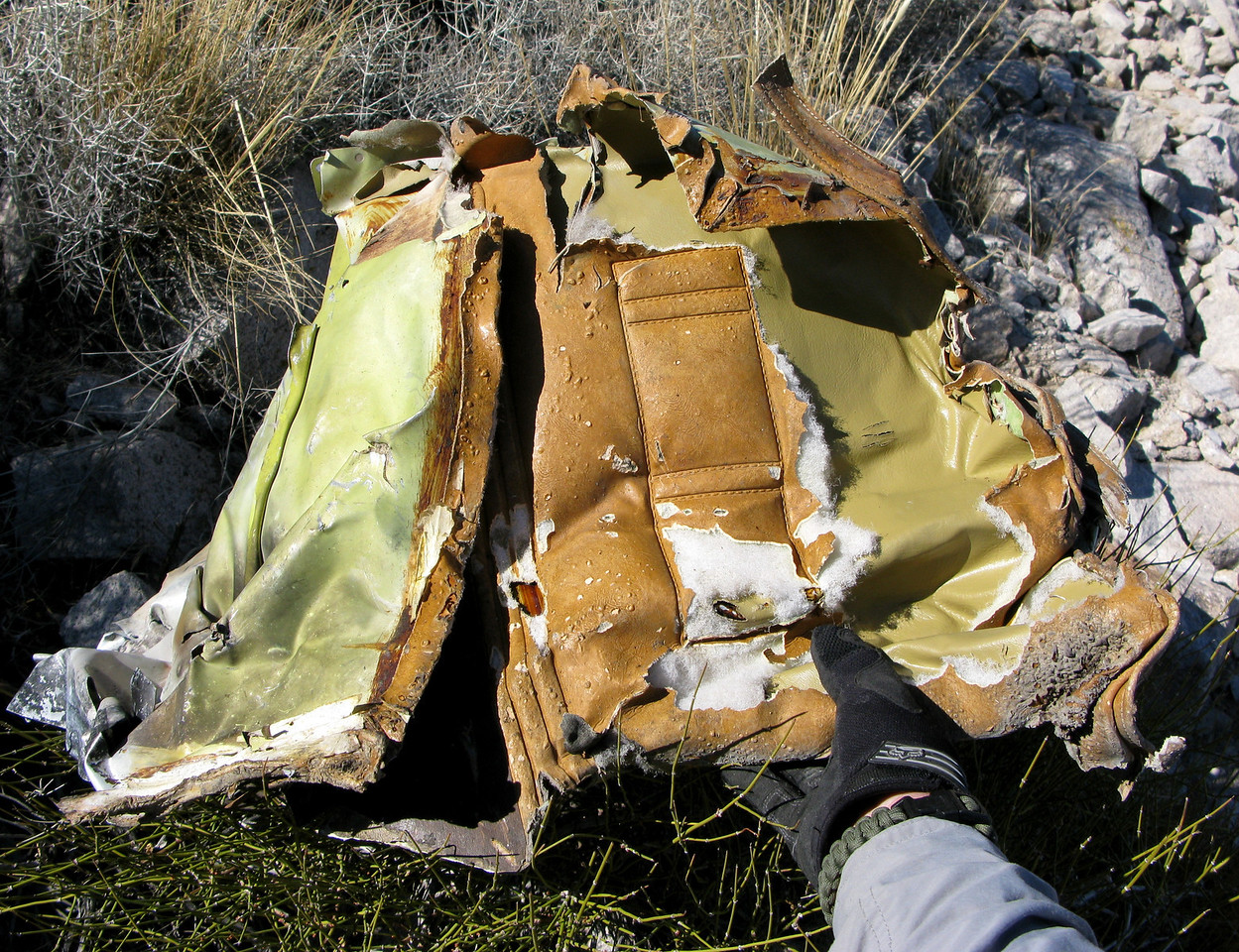 Some of the vinyl interior fabric from the passenger cabin had evidence of heat damage, but for the most part this fragment escaped much of the fire.