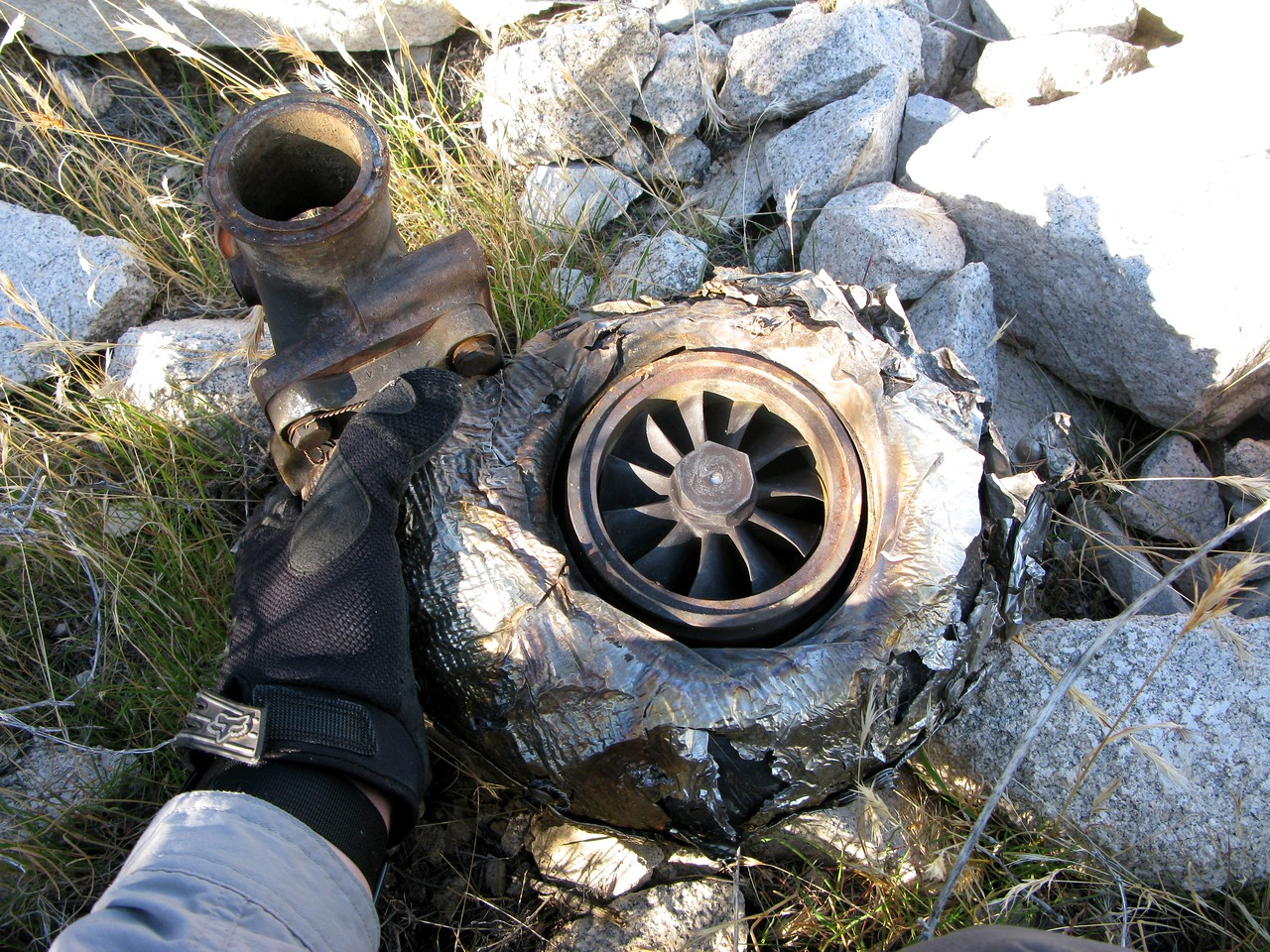 A Garrett Airesearch Turbocharger exhibited few signs of damage in the accident.<br /> <br /> Each engine on the Piper Chieftain had one turbocharger installed. They are used to maintain engine performance at higher elevations.