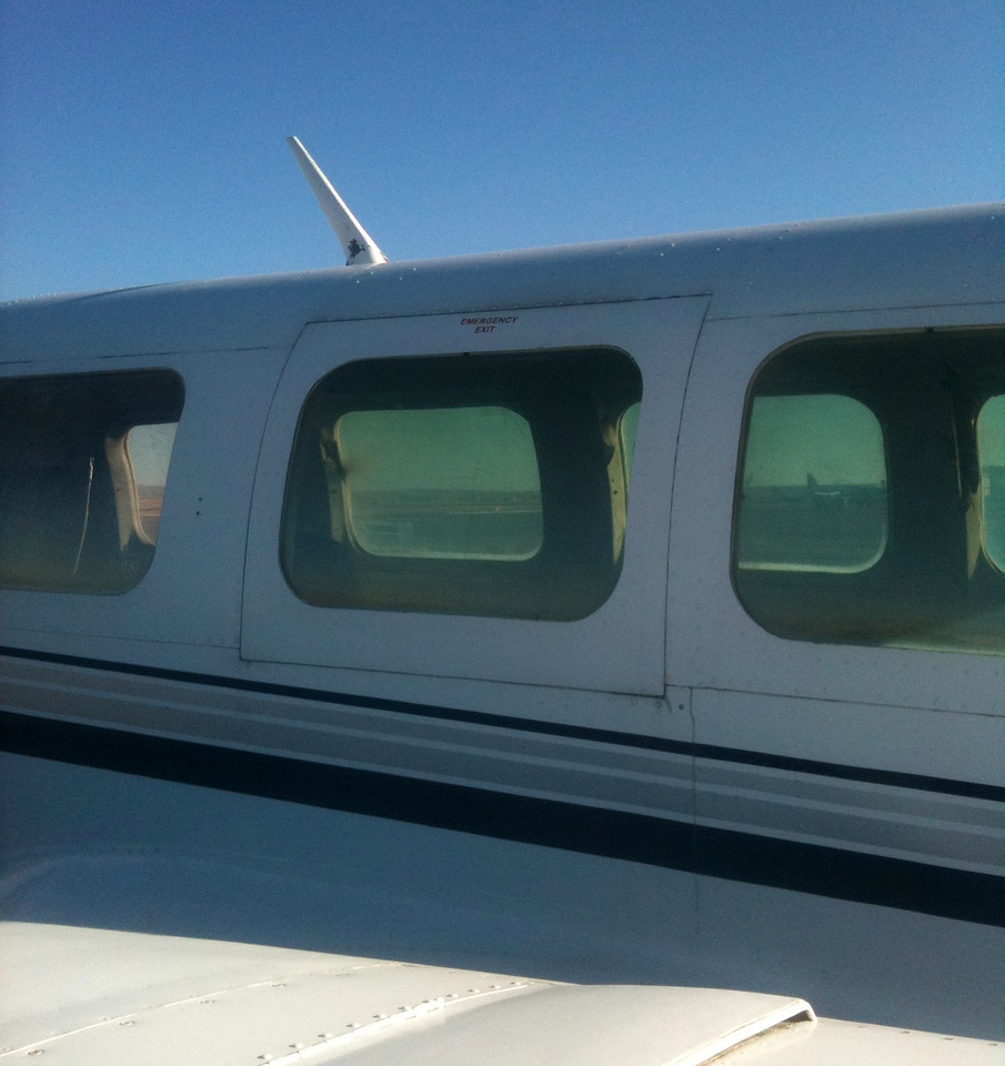 An over-wing emergency exit on a Piper PA-31-350 Chieftain.