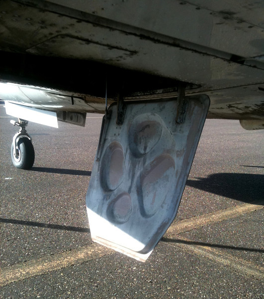 An un-damaged example of the left main landing gear inner door on a Piper PA-31-350 Chieftain. <br /> <br /> These hydraulically actuated doors are normally closed except during the landing gear extension and retraction sequence. They can also be mechanically opened on the ground if needed for maintenance inspections.<br /> <br /> A thank you to American Aviation of Page, Arizona for allowing me to examine and technically photograph their Piper Chieftain for this study.