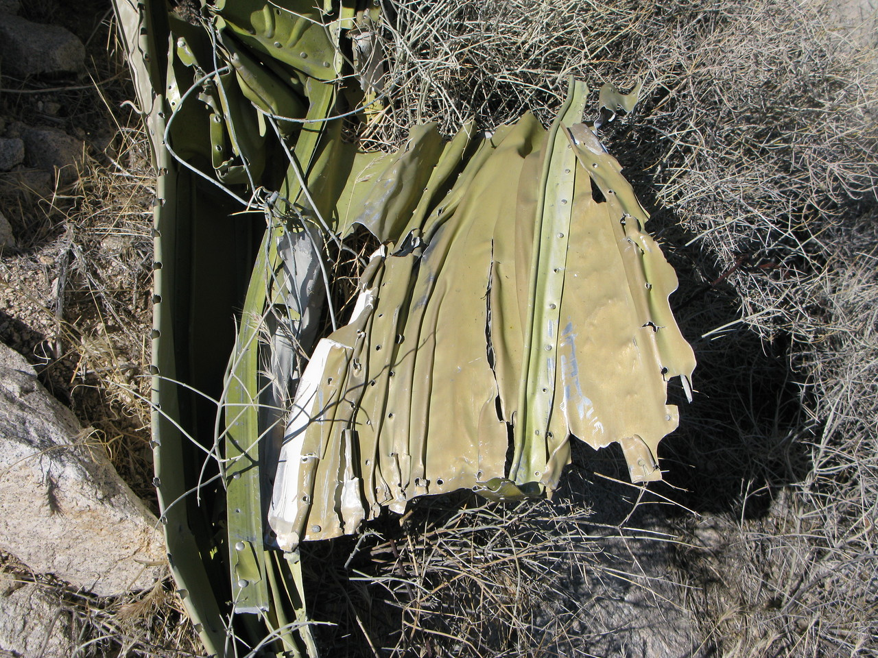 """The compressed """"accordion"""" like crush pattern on the wing's leading edge reminded me of wing fragments found at the Las Vegas Airlines Flight 88 crash site in the Grand Canyon."""
