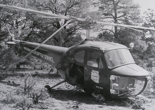 "During the summer of 1948, a combination of lifting too much on a hot day with not enough power resulted in this Bell 47 helicopter landing hard in the trees.<br /> <br /> The accident occurred about 1.5 miles north of Grand Canyon/Red Butte Airport during an attempt to ""sling load"" a surplus military Quonset hut to Havasupai Canyon."