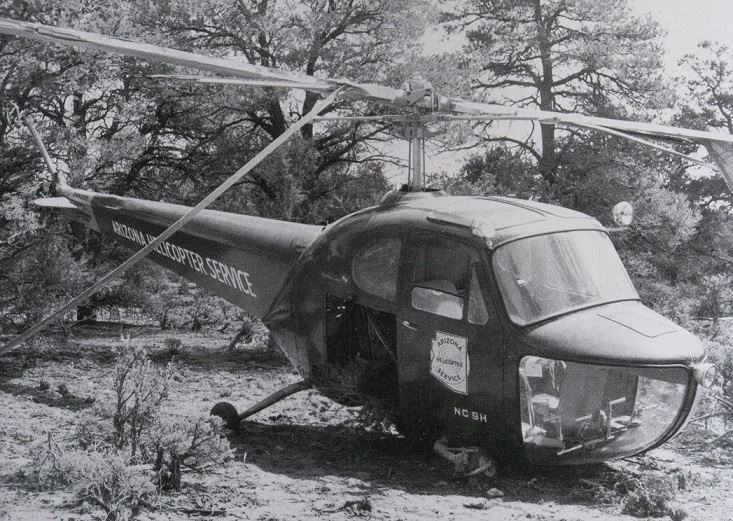 """During the summer of 1948, a combination of lifting too much on a hot day with not enough power resulted in this Bell 47 helicopter landing hard in the trees.<br /> <br /> The accident occurred about 1.5 miles north of Grand Canyon/Red Butte Airport during an attempt to """"sling load"""" a surplus military Quonset hut to Havasupai Canyon."""
