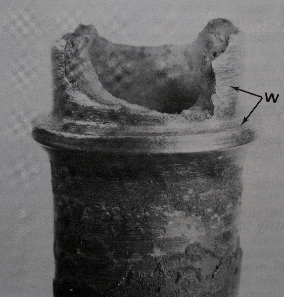 During the accident investigation, the NTSB focused on the left engine that was trailing smoke.<br /> <br /> This fractured exhaust valve guide from the number 5 cylinder exhibited progressive cracking before it failed. The NTSB suspected that the fractured valve guide probably damaged turbocharger's turbine wheel blades before the cylinder was replaced four days before the accident. <br /> <br /> Scenic Airlines maintenance personnel failed to detect the damage to the turbocharger. (NTSB File Photo)