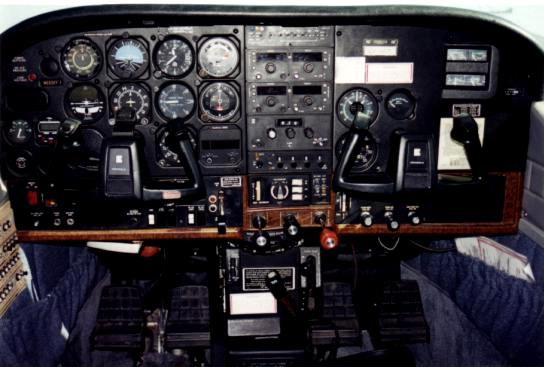 The instrument panel on the Cessna 210L was basic for 1995, but was equipped to operate the aircraft safely at night or in instrument visibility conditions.