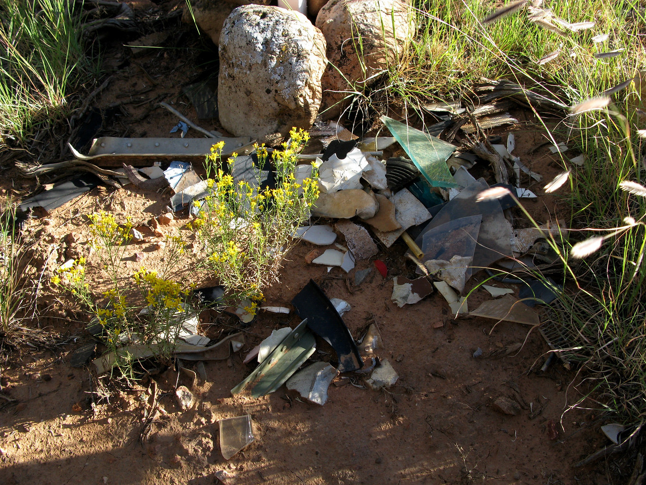 At the base of the crosses is a collection of aircraft wreckage that was gathered by visitors or family members. Some of the debris was not consistent with parts and components from a Cessna 210 and was probably pieces from other accidents that have occurred in the same area.<br /> <br /> An area roughly 50 feet in diameter surrounding the memorial contains additional smaller fragments that may be from the accident aircraft.