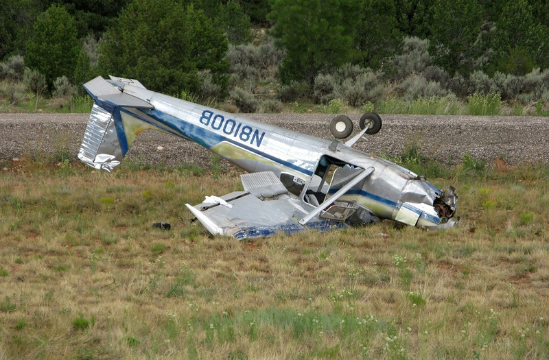 July 28, 2012 <br /> <br /> This Cessna 172 ended up on it's back after the pilot attempted a go-around from an aborted landing. Poor flying technique combined with high density altitude conditions resulted in a crash. Minor injuries for the two on board.