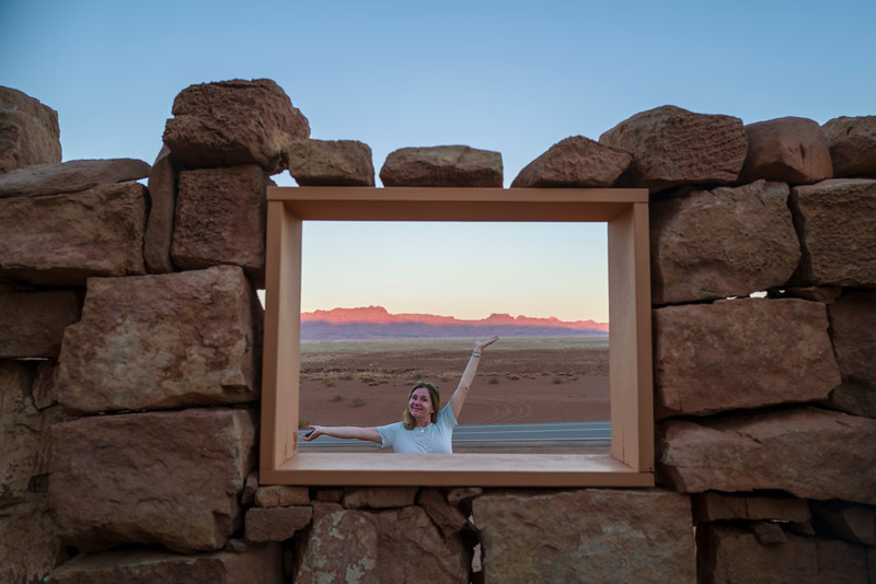 Patricia is happy by the window at Cliff Dwellers Marble Canyon, AZ.