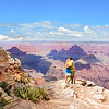 Loving embracing couple standing on top of mountain, looking at beautiful mountain  landscape, on hiking trip. .Grand Canyon National Park, Arizona, USA.