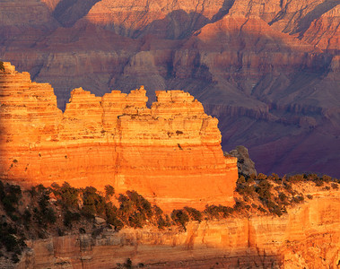 Grand Canyon National, AZ/Park, North Rim, Cape Royal aglow at sunset as light leaves in south rim in the background. 893h8