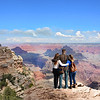 Family enjoying beautiful Grand Canyon landscape.