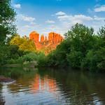 Beautiful Cathedral Rock reflected in water. Oak Creek at Red Rock Crossing, Crescent Moon Picnic, Sedona, Arizona, USA.