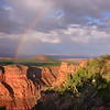 Beautiful double rainbow after thunderstorm at sunset.
