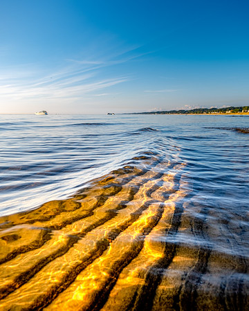 Sand Ripples Beneath the Waves