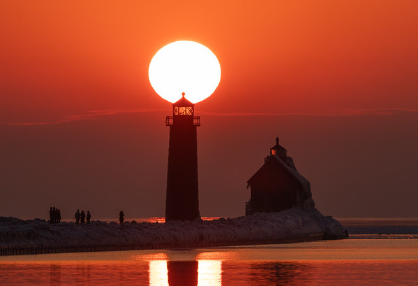 The Sun Perched Atop the Grand Haven Lighthouse