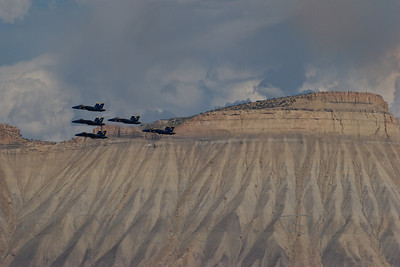 Blue Angels flying in front of Mt Garfield (Bookcliff mountain range). Grand Junction is in the Grand Valley, Western Colorado... surrounded by mountains. The airport is really close to the Bookcliffs, interviews with the Blue Angels note how close the mountains are around the valley, especially at the airport. :)