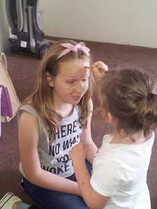 Face painting to prep for skits made up by our campers
